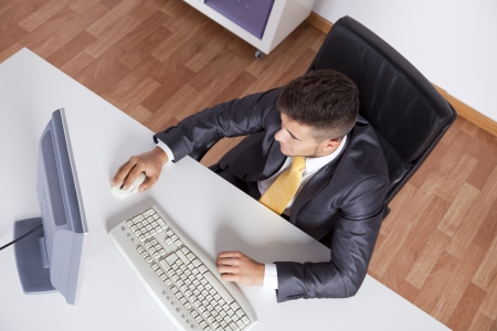 office use: Businessman at his office using his desktop computer