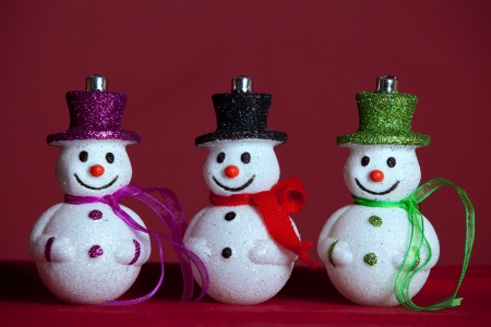 Snowman christmas decoration with red background (selective focus) photo