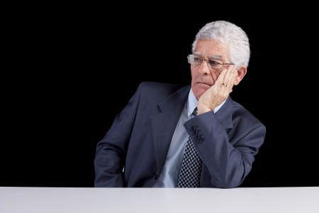 Senior businessman looking away to the copyspace (isolated on black) Stock Photo - 23489303