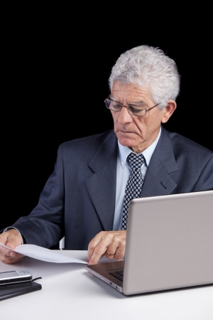Senior businessman working with his laptop at his office Stock Photo - 23489304