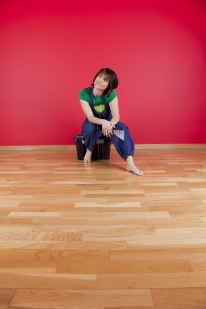 woman relaxing at her house after repairing her red wall
