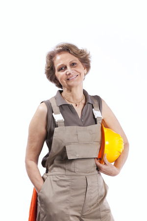 Happy senior woman holding a safety hat (isolated on white) photo