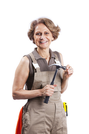 Senior woman with a hammer (white background) Stock Photo