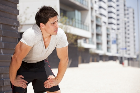 Athlete man tired after a long running sport event in the city Stock Photo