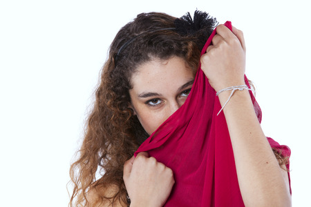 Young woman hidding her face with a red tissue (isolated on white) photo