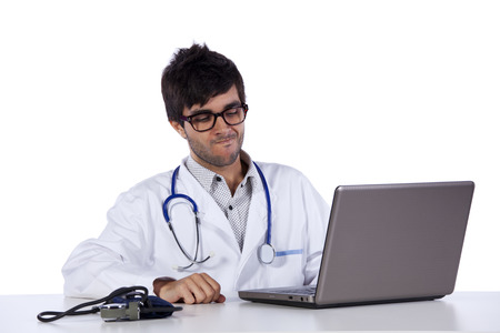 young doctor working at his desk (isolated on white)