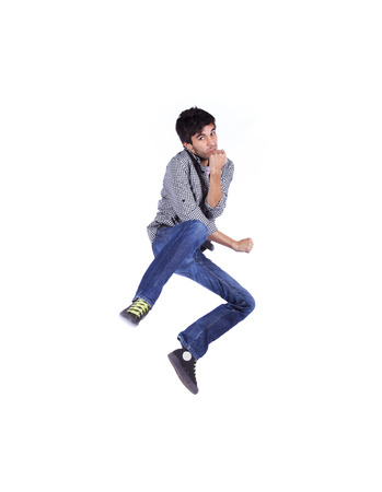 Young man jumping isolated on white (some motion blur) photo