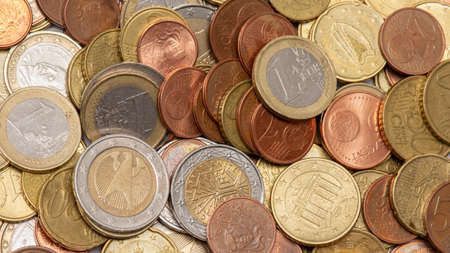 Bulk of various euro coins from different countries in Europe