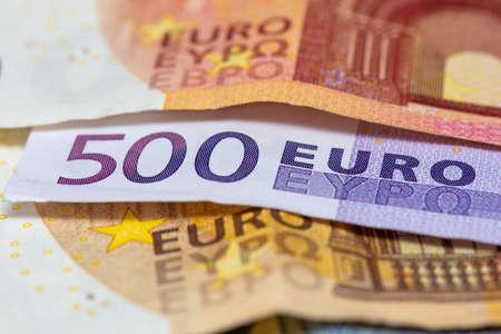 500 euro bank note among 50 and 10 euro bank notes. Close-up view