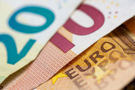 """Close-up view on euro bank notes with the word """"euro"""""""