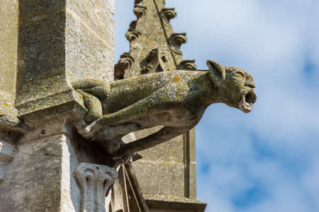 Gargoyle on the facade of the Saint-Pierre church, historical monument of gothic style, Dreux, France Banque d'images
