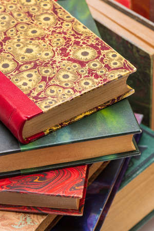 Stack of old books with ancient bindings