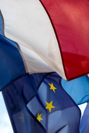French and European Union flags fluttering together in the wind. Close-up shot