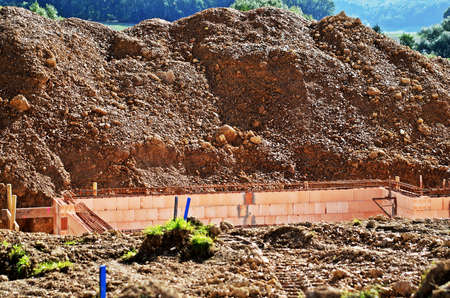 housebuilding: building site with mount of earth Stock Photo