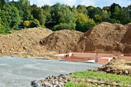 housebuilding: Building site with mound of earth