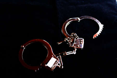 exempt: police handcuffs