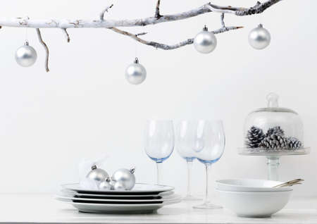 on silver: Christmas decoration table display in silver frosty icy tone, simple minimalist elegant design Stock Photo