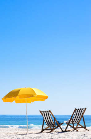 Two sun loungers and an umbrella on a perfect sunny day  Stock Photo