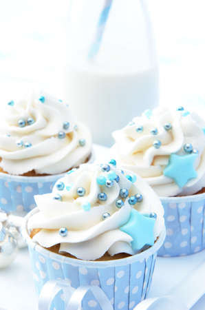 Frosty icy winter xmas theme cupcakes with white icing and blue decorations  photo