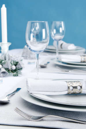 Dinner service christmas table place plate setting decoration in cool silver icy theme Stock Photo - 15555795