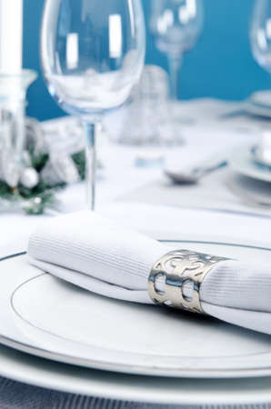 setting table: Dinner service christmas table place plate setting decoration in cool silver icy theme