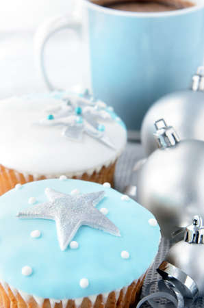 Christmas cakes with silver bauble decorations and hot chocolate photo