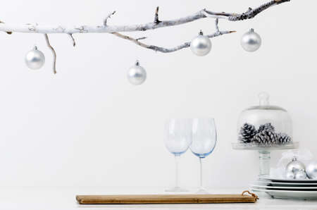 setting table: Christmas decoration table display in silver frosty icy tone, simple minimalist elegant design Stock Photo
