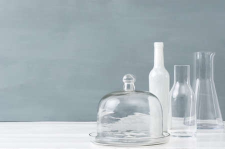 table top: Minimalist interior simple modern elegant decorating table top with grey background, glass bottles and lots of copy spce Stock Photo