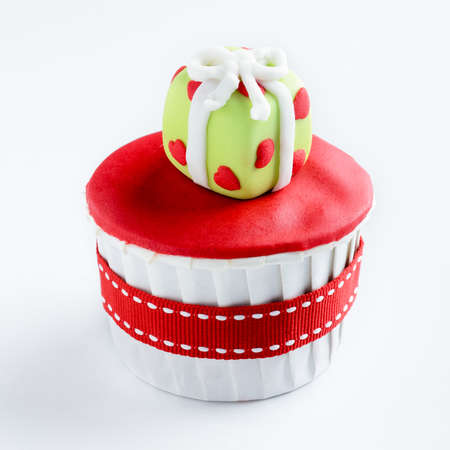 Christmas cupcake in traditional red green colours with present gift box decorative element  photo