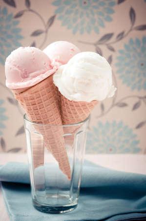 Italian gelato scoops on sugar cones with soft nostalgic warm retro tone photo