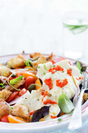 Mix salad with baby cherry tomatoes, onion, micro greens and fresh mozzarella cheese  photo