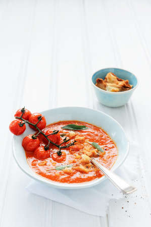 Tomato vegetable red soup with fresh herbs and croutons, healthy meal and snack   Stock Photo - 15549726