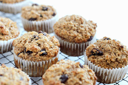 Healthy freshly baked wholewheat bran muffins on cooling tray