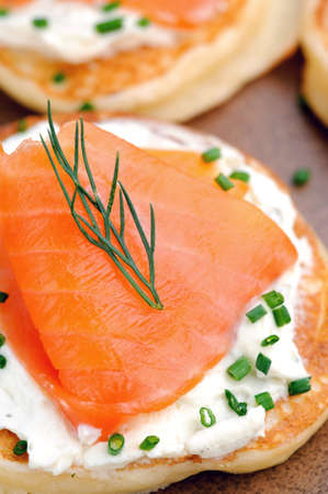 appetiser: Close up on a smoked salmon appetiser garnished with dill and chives