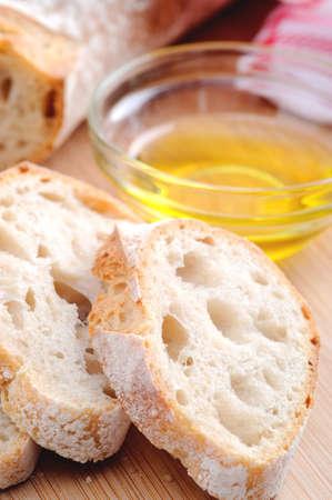 appetiser: Common Italian appetiser; sliced baguette served with olive oil  Stock Photo