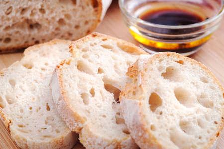 appetiser: Common Italian appetiser; sliced baguette served with olive oil and balsamic vinegar  Stock Photo