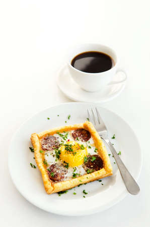 savoury: Savoury tart and a strong black coffee for breakfast, on a white background