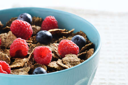 Bowl of cereal full of dietary fibre and vitamins photo