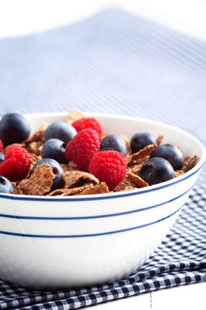Start the day with a nutritious and delicious bowl of cereal with fresh fruit filled with vitamins and antioxidants Stock Photo - 15564901