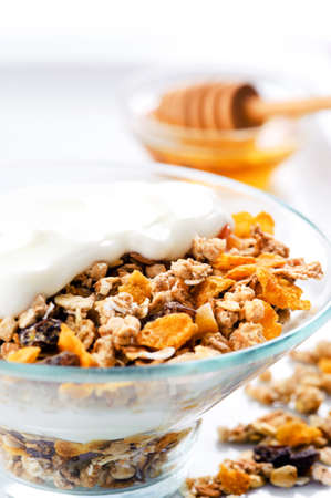 Healthy granola in glass bowl with plain yoghurt  photo