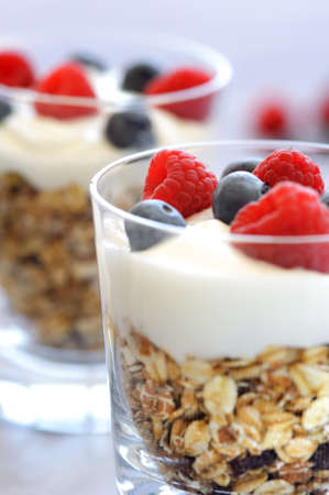 Layered breakfast cereal with yoghurt and fresh berries  photo