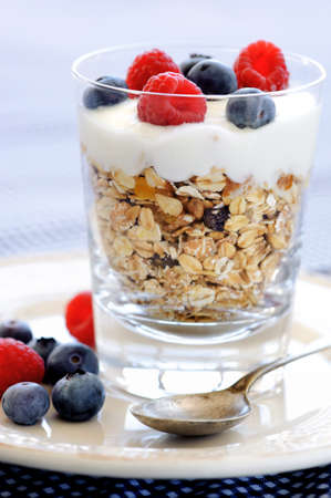 Delicious oats with yoghurt, raspberry and blueberries   photo