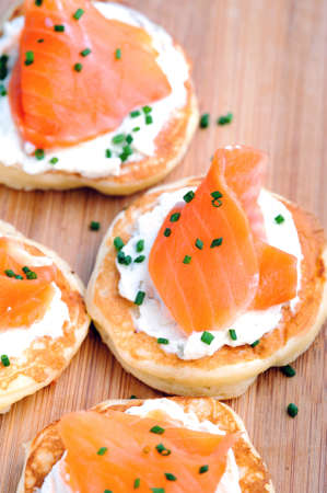 Platter of bite size smoked salmon appetisers suitable for a party  photo