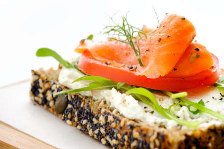 Smoked salmon and salad on a slice of toasted wholewheat bread, a light meal option photo