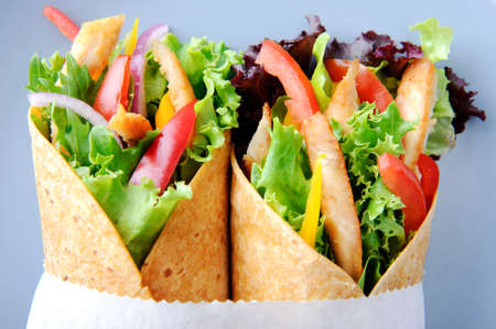 Delicious healthy meal consisting of a chicken burrito with plenty of fresh raw salad  Stock Photo - 15565875
