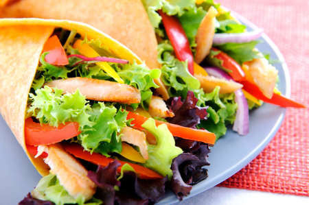 Healthy chicken strips and fresh salad wrapped in a corn tortilla  Stock Photo - 15565874