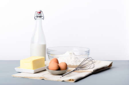 Baking still life with raw ingredients, flour, butter, eggs, milk to make dough, cakes, cookies Stock Photo - 15884355