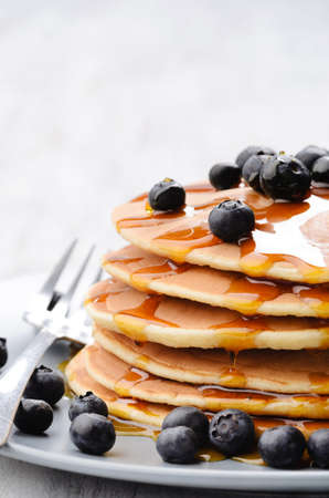 hotcakes: Pancake stack with fresh blueberries and maple syrup, plenty of copy space Stock Photo