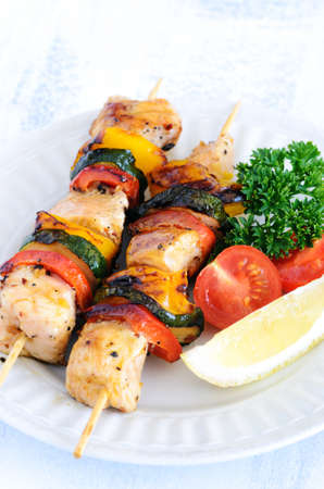 shish: Vegetable and chicken skewers kebabs, a perfect healthy summer barbeque meal Stock Photo