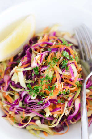 appetiser: Serving of coleslaw a healthy vibrant colourful salad made with shredded raw cabbage, carrots and onions